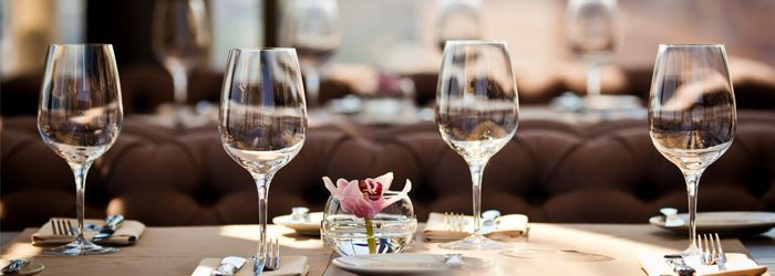 Rows of white wine glasses